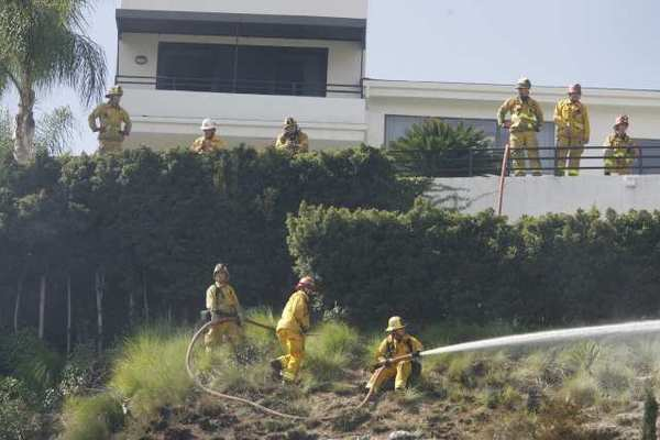 Glendale firefighters put out a small grass fire at the 1900 block of Deermont Road in Glendale.