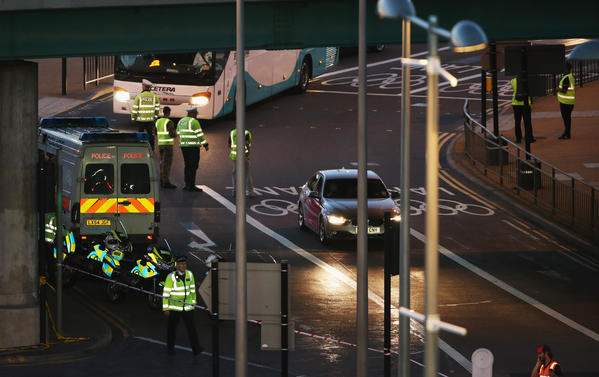 A damaged bicycle lays next to an Olympic bus. Police surrounded the scene of a bus accident that killed a cyclist.