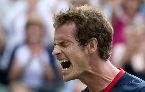 Britain's Andy Murray celebrates after defeating Cyprus' Marcos Baghdatis in a third-round men's singles tennis match at the All England Tennis Club in Wimbledon.