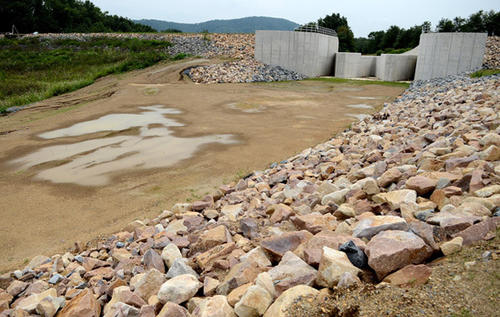 This is the reconstructed dam at the spillway of Leaser Lake in Lynn Township Wednesday. The lake is still drawn down as the dam rehabilitation project is not yet complete.
