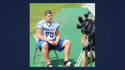 Windber's Shane Almodovar speaks with a reporter during WestPAC football media day on Wednesday in Portage.