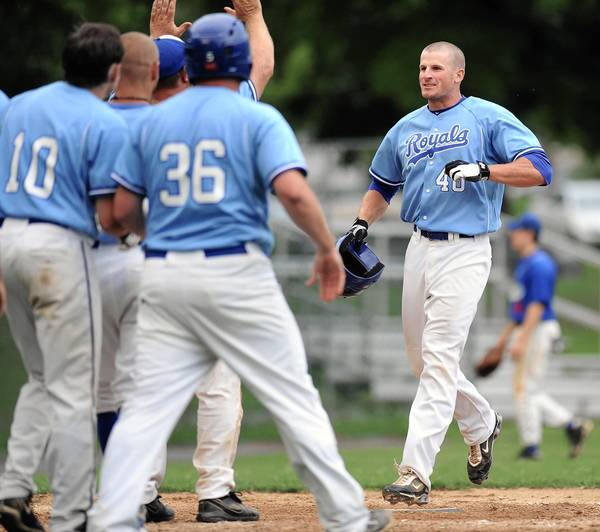 Hellertown's #40 Mark Angelo crosses home plate after hitting the game-winning home run in the 7th inning of a Blue Mountain League baseball playoff game against Limeport held at Dimmick Park on Wednesday.