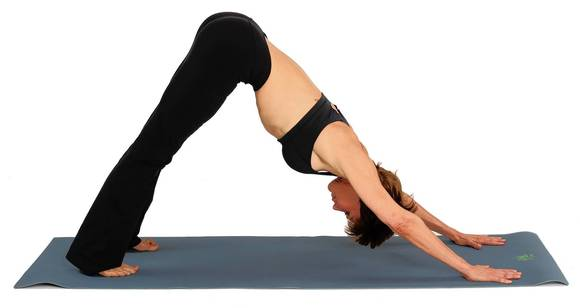 Keeping your hands in the same place, raise your hips to the ceiling and move your chest towards your thighs until your knees are straight.