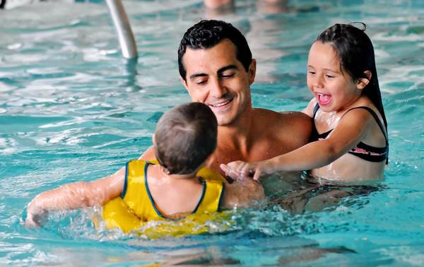 Joe Goodwin and his children enjoy the indoor pool at Regency Place, an Oakbrook Terrace apartment community that opened in 2007.