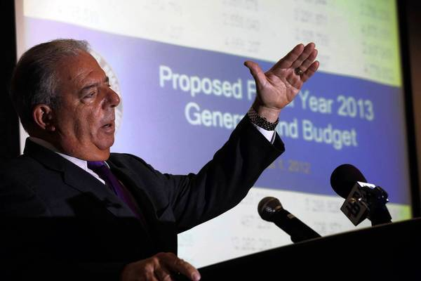 Long Beach Mayor Bob Foster unveils the proposed 2013 budget during a news conference Wednesday at the Miller Family Health Education Center.