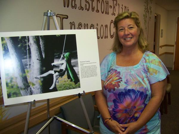 Ann Marie Boettger stands next to a photograph she took of her son, Crosby. The photographed served as inspiration during her recent battle with cancer, and was chosen for a national, traveling art exhibit.