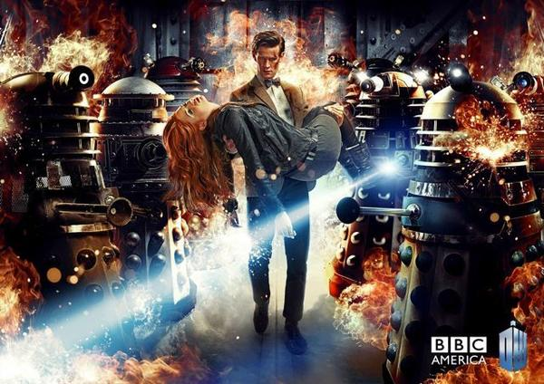 "The Doctor carries Amy Pond through a group of Daleks in this Season 7 ""Doctor Who"" poster."