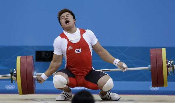 Sa Jae-hyouk of South Korea reacts after getting injured.