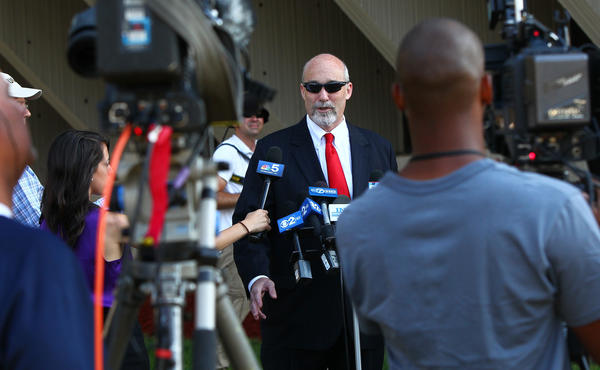 Drew Peterson's attorney Joel Brodsky talks to reporters as he arrives at the Will County Courthouse today.
