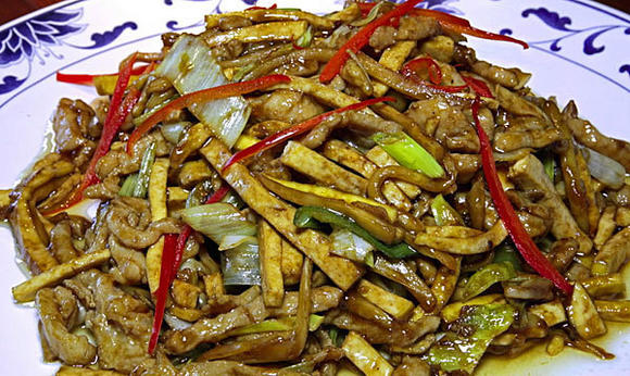 From the Chinese-only menu: I can speak enthusiastically of xiang qian rou si, above, a superb stir fry of strips ¿ pork strips, tofu strips, leek and bamboo strips.
