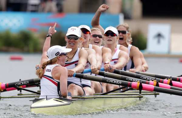 The U.S. team celebrates its gold medal. Members are Mary Whipple, Caryn Davies, Caroline Lind, Eleanor Logan, Meghan Musnicki, Taylor Ritzel, Esther Lofgren, Susan  Francia and Erin Cafaro.