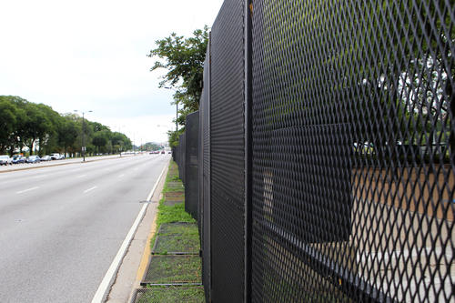 Tall metal fences line Lake Shore Drive as Lollapalooza preparations continue in Grant Park.