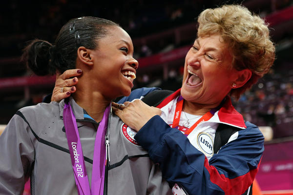 Gold medal U.S. gymnast Gabrielle Douglas celebrates her win with team coordinator Martha Karolyi after the Artistic Gymnastics Women's Individual All-Around final on Day 6 of the London 2012 Olympic Games.