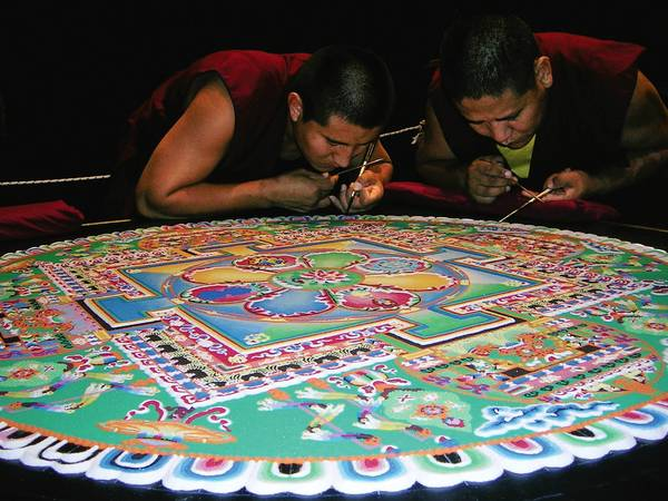 The Buddhist monks of the Drepung Loseling Monastery are visiting The American Theatre in Hampton. In this photo, they construct a mandala or sand painting.