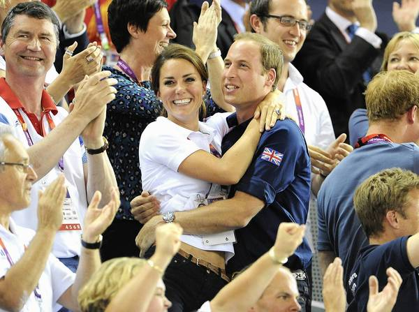 Catherine, Duchess of Cambridge and Prince William, Duke of Cambridge embrace at the Velodrome in London, England where they came to watch the Men's team pursuit qualifying rounds.