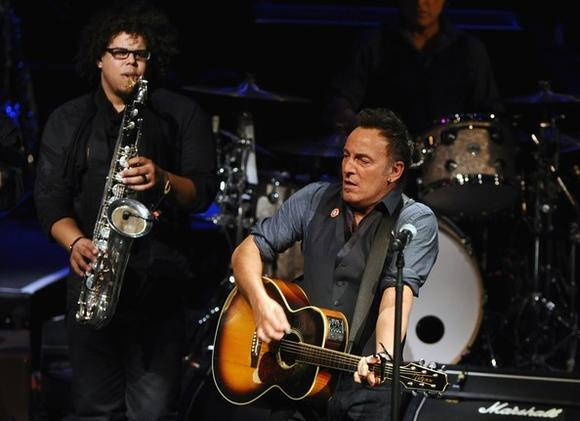 Jake Clemons, left, rocks with Bruce Springsteen