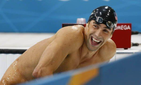 Michael Phelps reacts to his win in the 200M IM.