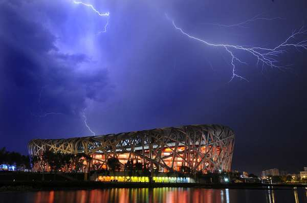 Lightning fills the sky above the Bird's Nest on the eve of the Beijing Olympics' closing ceremony.