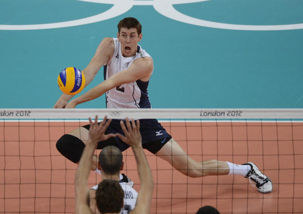 United States player Sean Rooney (2) hits the ball against Brazil during the London 2012 Olympic Games at Earls Court.