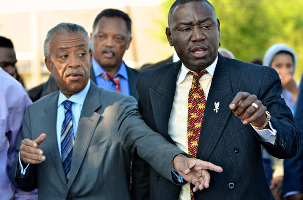 The Rev. Al Sharpton, Jesse Jackson and Benjamin Crump, attorney for the Trayvon Martin family, join together in Sanford on March 26.