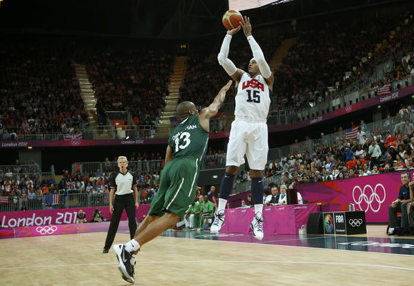 Carmelo Anthony (L) of the U.S. shoots over Nigeria's Derrick Obasohan