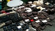 Counterfeit accessories valued at nearly $400,000 were seized by Laguna Beach police Thursday.