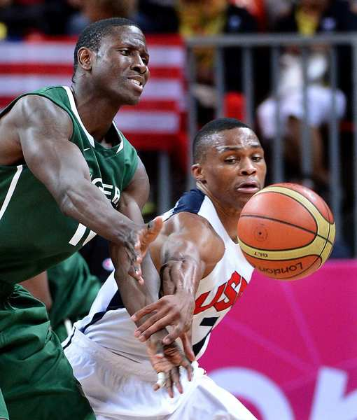 Team USA's Russell Westbrook, right, knocks the ball away from Nigeria's Koko Archibong .