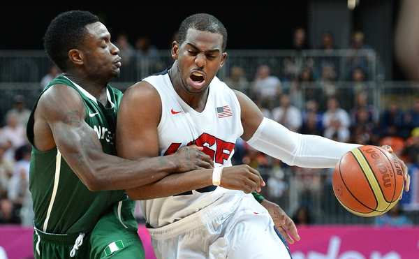 Chris Paul is fouled by Nigeria's Tony Skinn at the 2012 London Olympics.