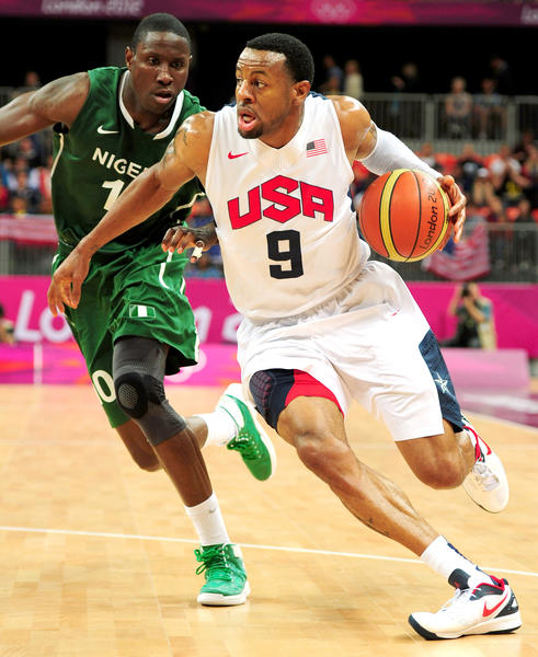 Team USA's Andre Iguodala, right, powers ahead of Nigeria's Koko Archibong. The Dream Team's starters played very little in the 156-73 win.