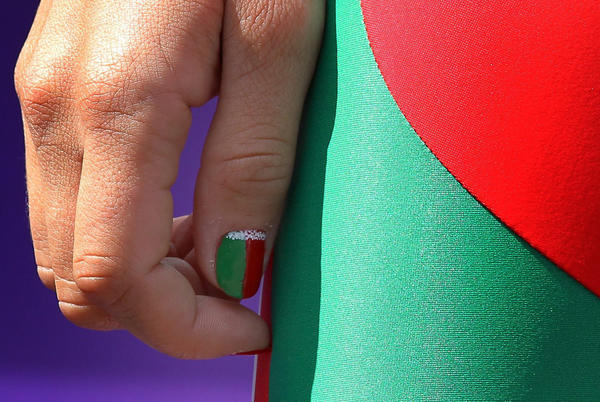 Cyclist Alena Amialiusik of Belarus sports national nail colors at the sign-in prior to the start of the women's road cycling race.