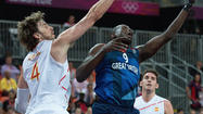 LONDON -- Two nail-biting finishes kept the pot boiling at the top of Group B in the men's Olympic basketball on Thursday while a record-breaking romp underlined why United States are the favorites to land gold.