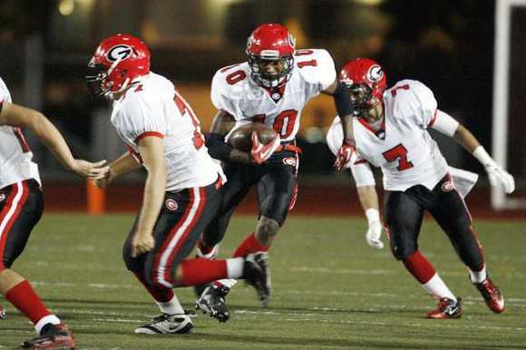 Glendale High wide receiver Mike Davis, center, committed to play Brigham Young University on July 27.