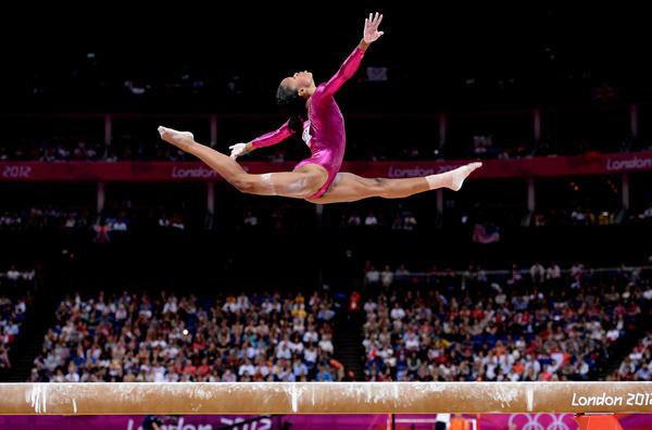 Gold medal winner Gabby Douglas competes on the beam in the women's individual all-around event.