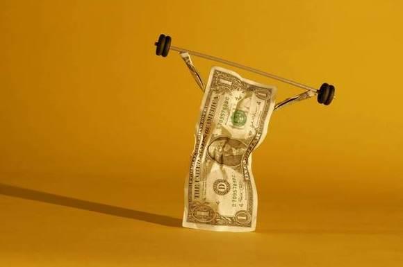 Dollar bill lifting weights
