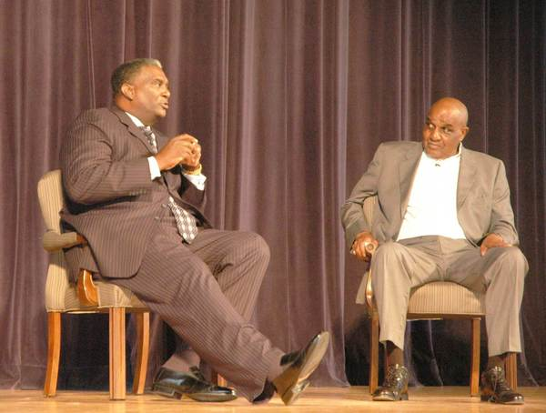"""Sweet"" Lou Dunbar (left) and Governor Vaughn relay stories of their days of playing with the Harlem Globetrotters Thursday at the John M. Hall Auditorium in Bay View."