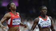 McCorory wins first-round heat in 400 meters, has 3rd-best overall time