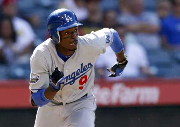 Dee Gordon singles during a Dodgers-Angels game.