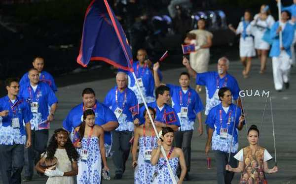 Guam's team enters Olympic Stadium during the opening ceremony.