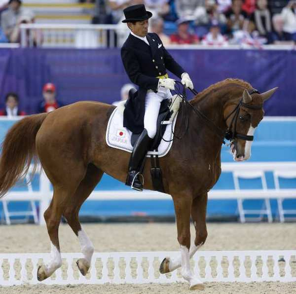 Hiroshi Hoketsu from Japan rides Whisper in the equestrian dressage competition.