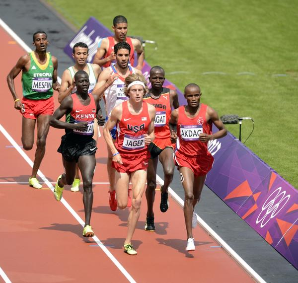 Evan Jager (USA) leads a pack of racers in the men's 300m steeplechase heats during the 2012 London Olympic Games at Olympic Stadium.
