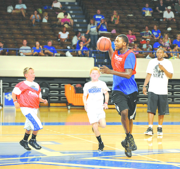 Michael Kidd-Gilchrist, top, the No. 2 pick in the June NBA draft, kept the ball away from youngsters at The John Calipari Pros Camp Thursday during a pickup game.