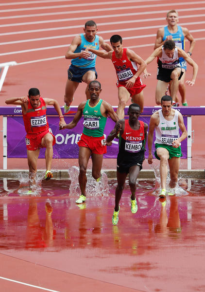 Donn Cabral clears the hurdle just behind L-R) Hamid Ezzine of Morocco, Roba Gari of Ethiopia, Ezekiel Kemboi of Kenya and Mohamed Khaled Belabbas of Algeria compete in the Men's 3000m Steeplechase Heats on Day 7 of the London 2012 Olympic Games at Olympic Stadium on August 3, 2012 in London, England.