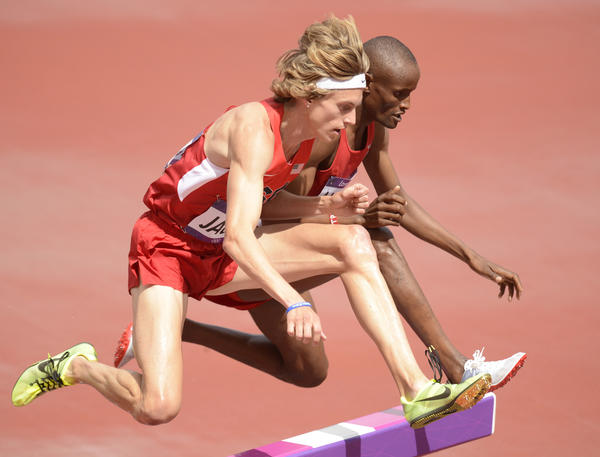 Evan Jager (left) and Tarik Langat Akdag compete during the men's 3,000-meter steeplechase heats Friday during the London 2012 Olympic Games at Olympic Stadium.