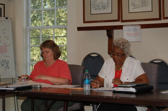 Perryville City Clerk Mona Followell, left, and Mayor Anne Sleet listen during Thursday's City Council meeting.