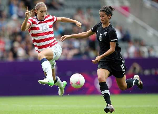 The United States' Alex Morgan, left, vies for the ball with New Zealand's Abby Erceg during their 's quarterfinal soccer match.