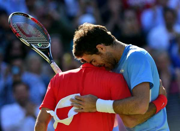 Juan Martin del Potro, right, and Roger Federer  embrace after the men's singles semifinals.