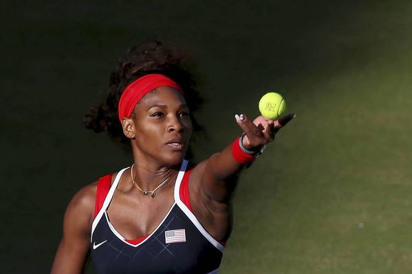 Serena Williams of the United States serves the ball to Victoria Azarenka of Belarus in the Semifinal of Women's Singles Tennis on Day 7 of the London 2012 Olympic Games at Wimbledon
