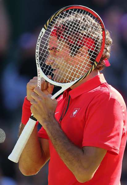 Roger Federer of Switzerland clenches his fist in victory after beating Argentina's Juan Martin del Potro on center court at Wimbledon. The match lasted almost five hours and was the longest in Olympic history.