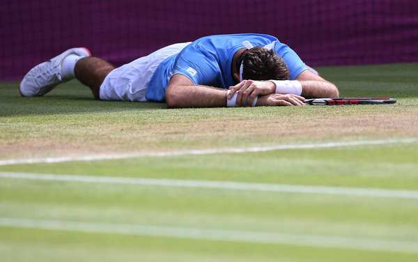 Juan Martin del Potro of Argentina suffers a cramp  midway through a marathon tennis match against Switerland's Roger Federer.