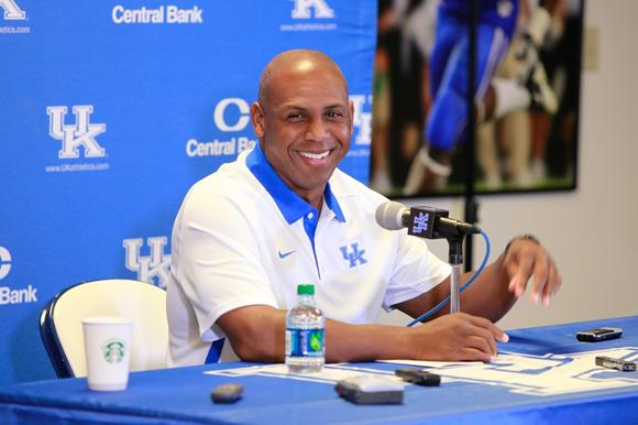Kentucky football coach Joker Phillips smiles during his team¿s annual Media Day Friday at Commonwealth Stadium. Phillips is entering his third season as coach of the Wildcats.